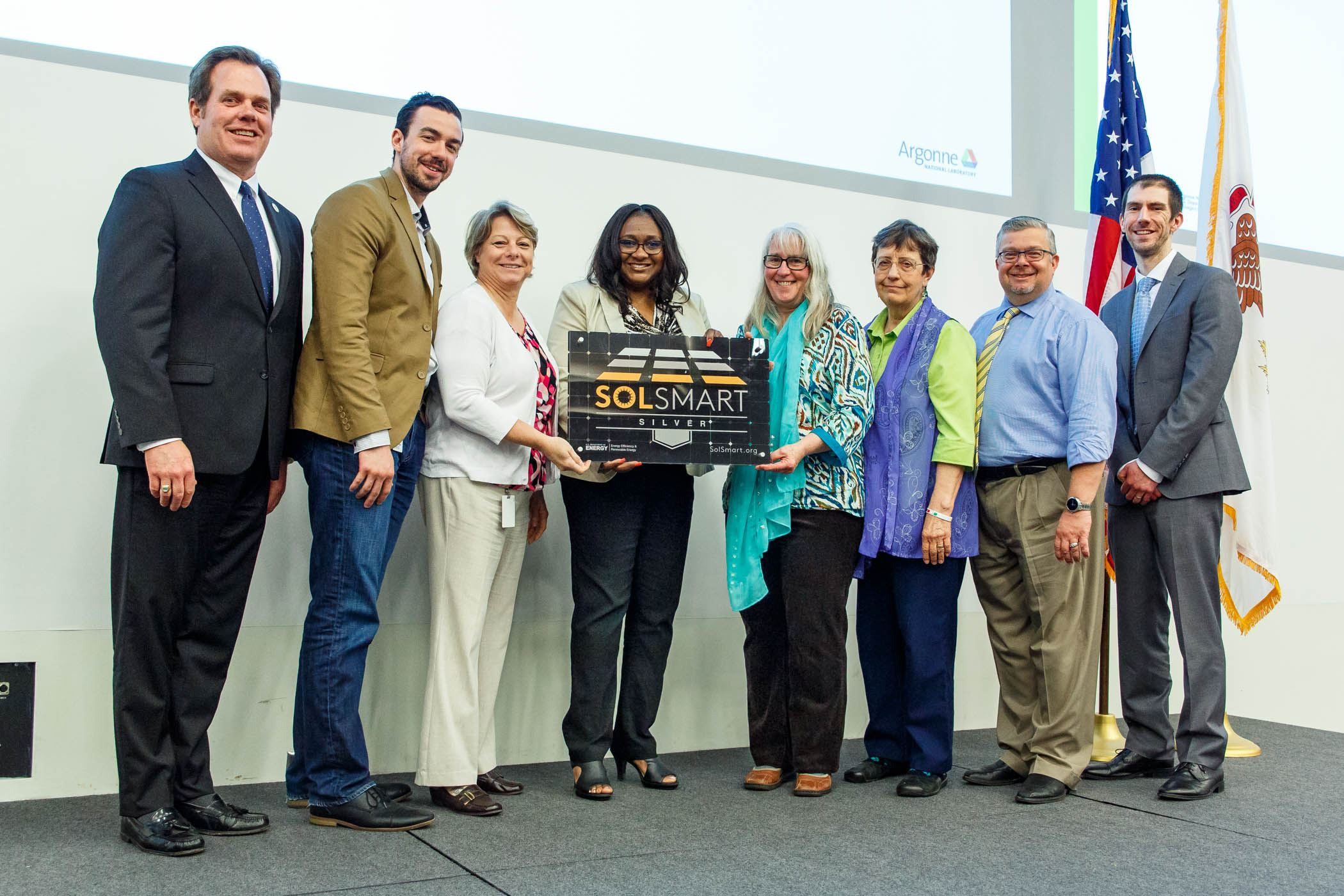 Elgin representatives hold SolSmart Silver Designation plaque