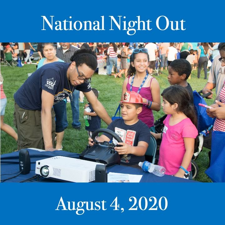 National Night Out. Kids exploring police items
