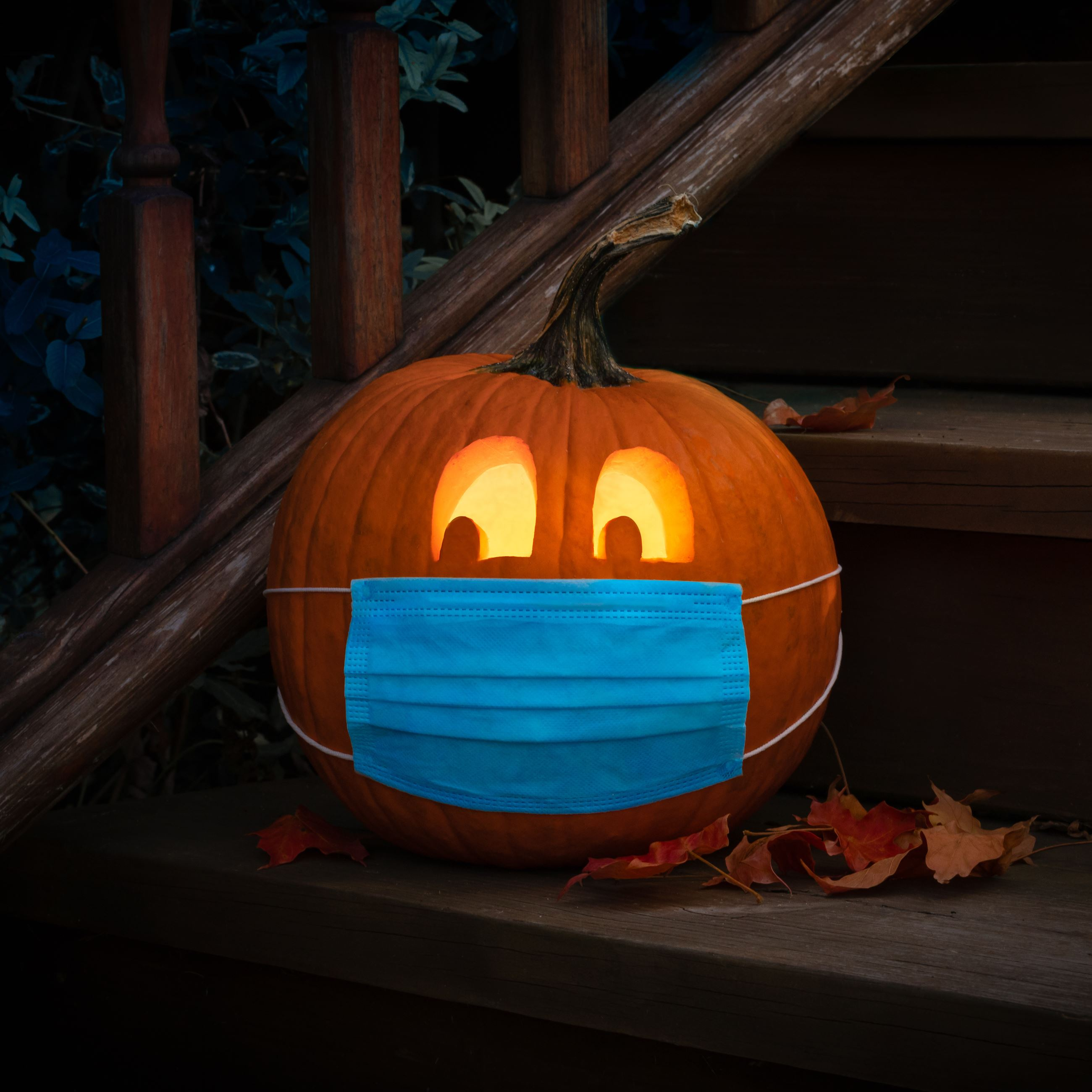 image of pumpkin on steps with mask